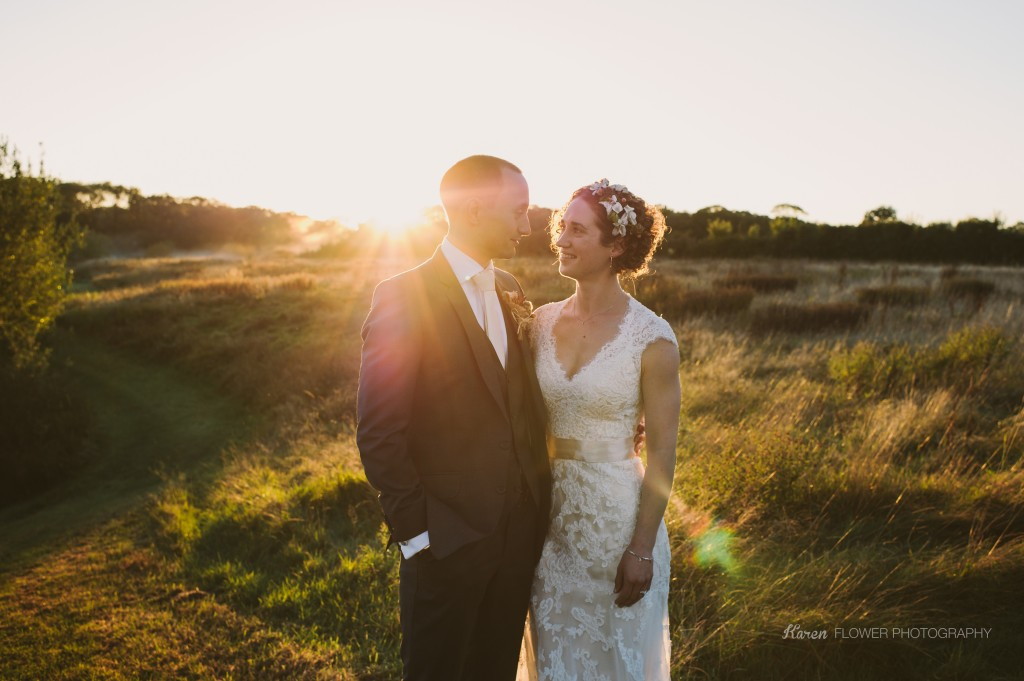 couple at sunset in a field