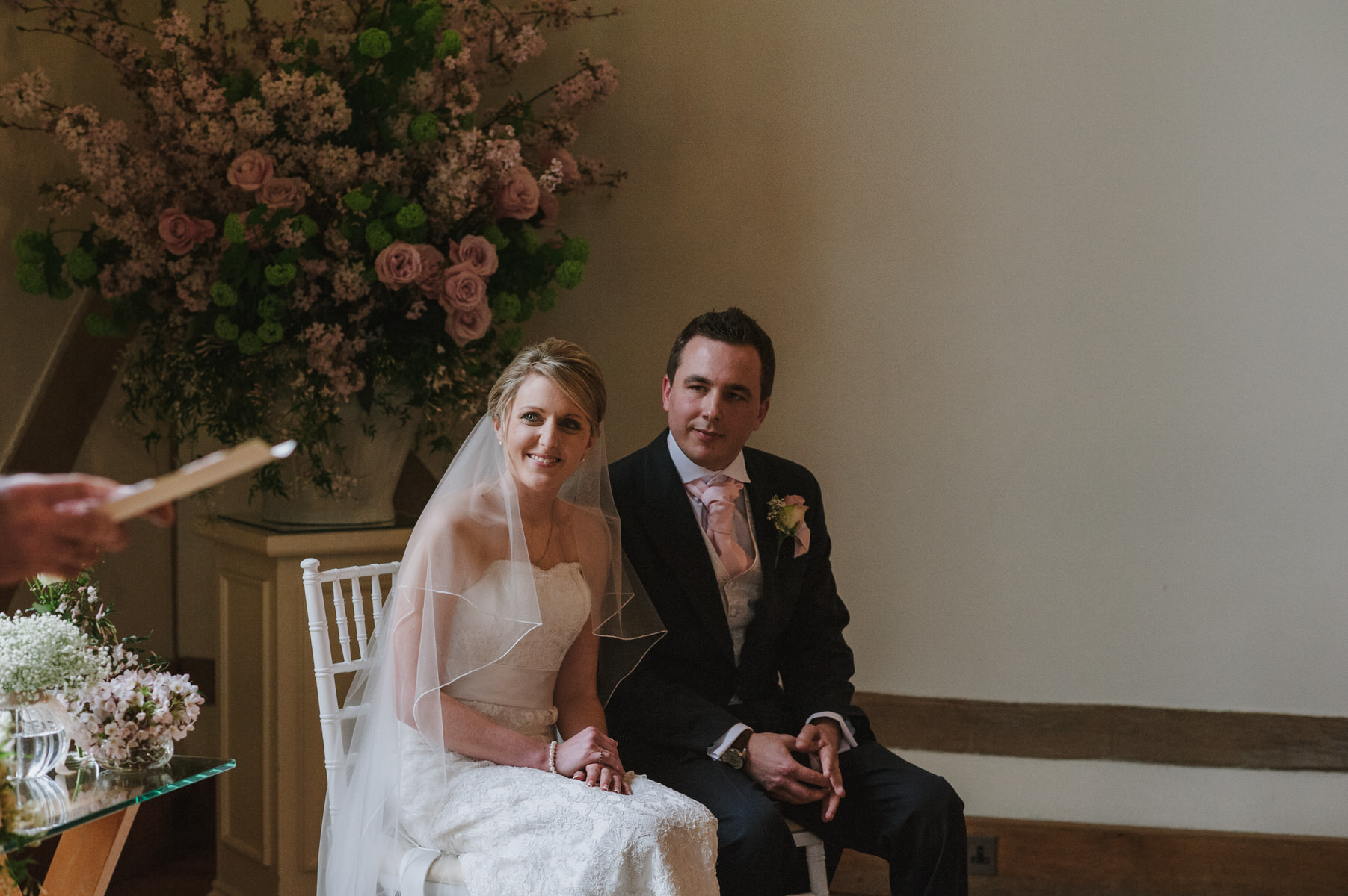 Cain Manor bride and groom listening to speech