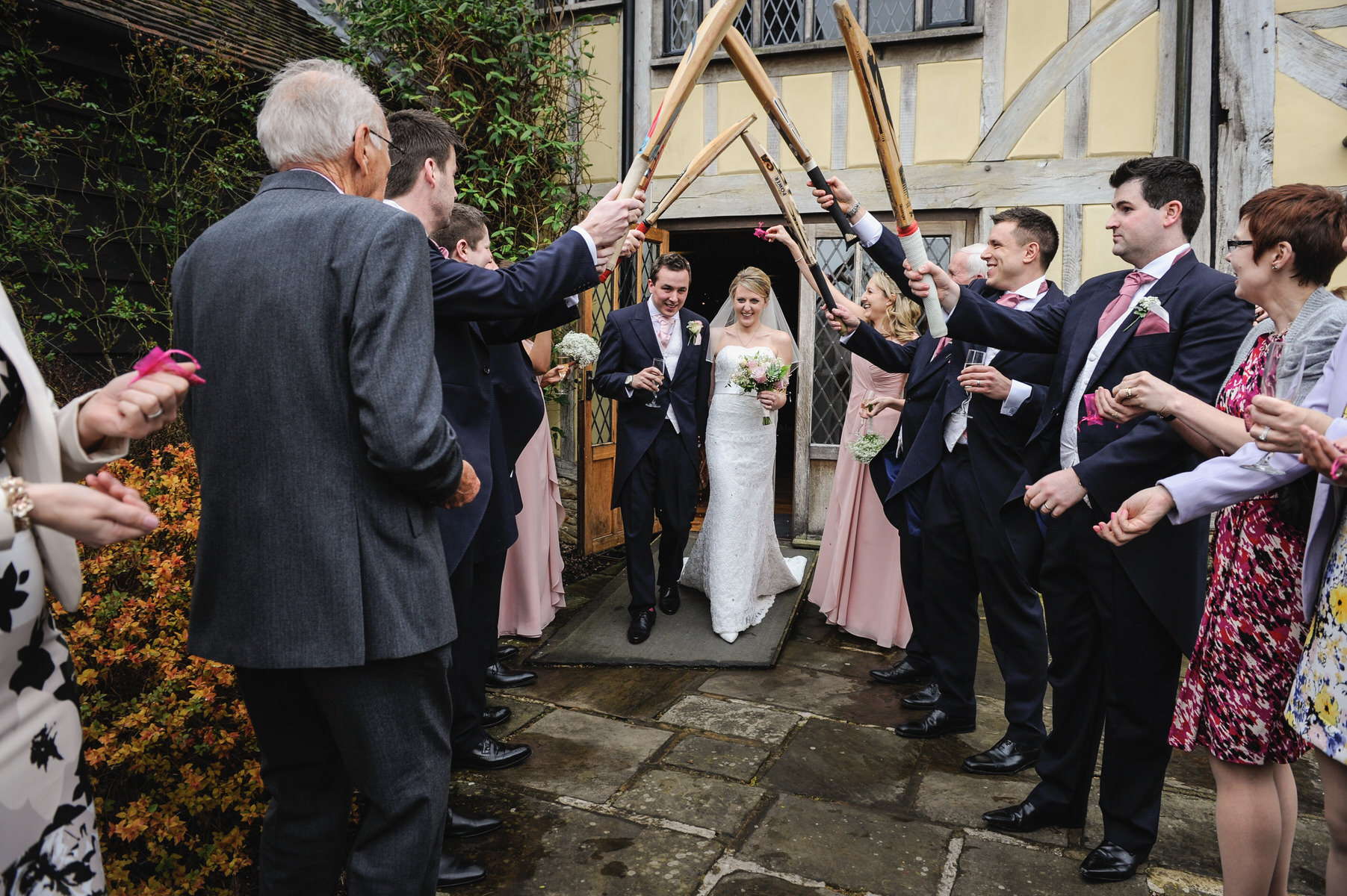 Cain Manor wedding couples exit under cricket bats