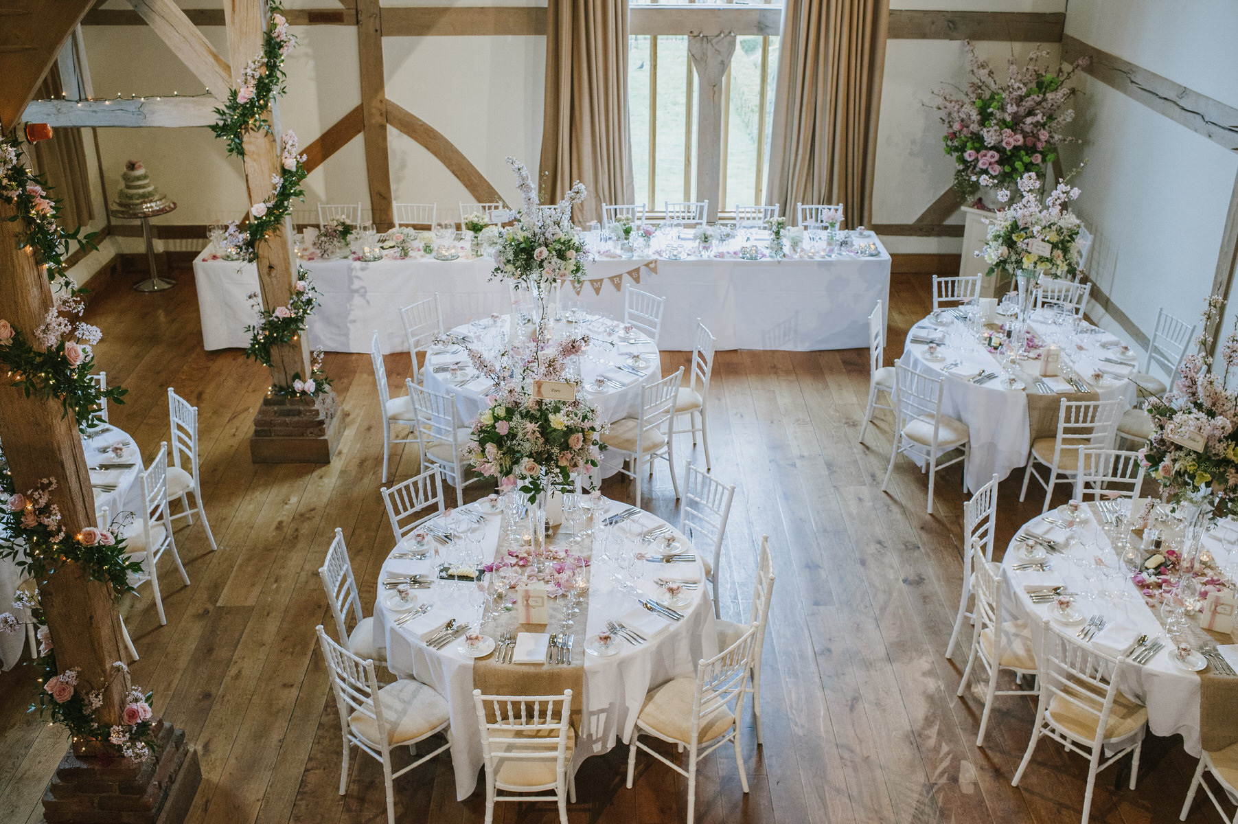 Cain Manor wedding reception room with pink flowers