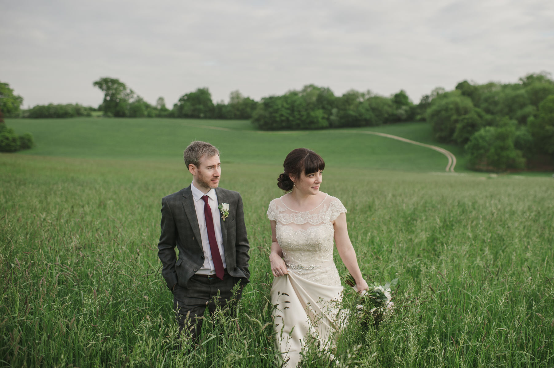 couples photos in field Herons farm wedding