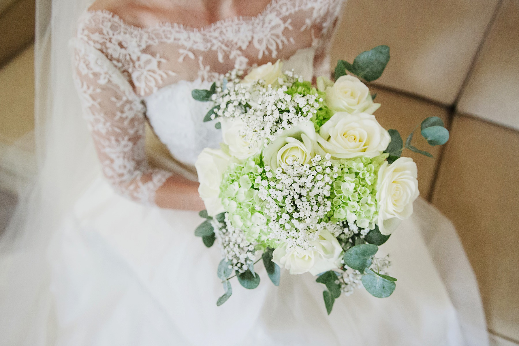 Great Fosters wedding photographer cream and pale green bridal bouquet