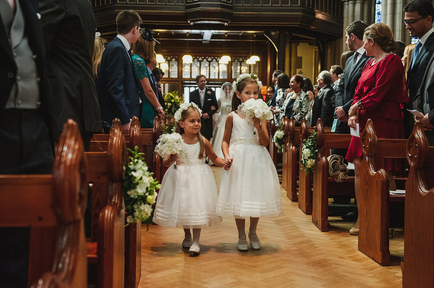 flower girls wearing ballet length dresses