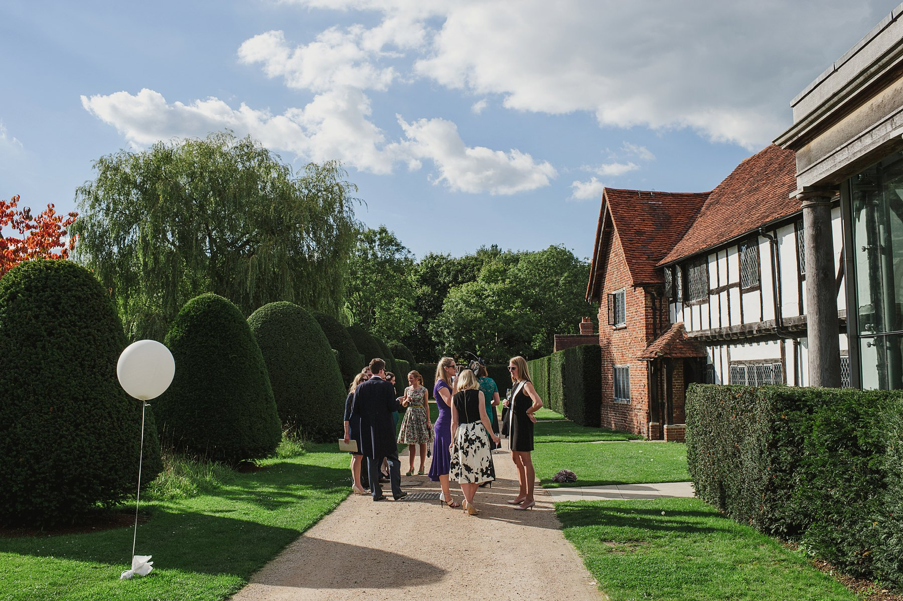 guests chatting at Great Fosters