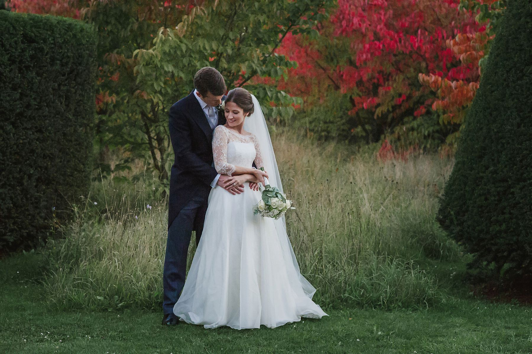 autumn wedding bride and groom at Great Fosters