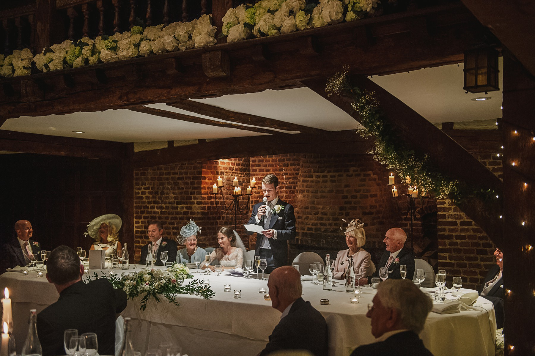 the tithe barn Great Fosters wedding photographer