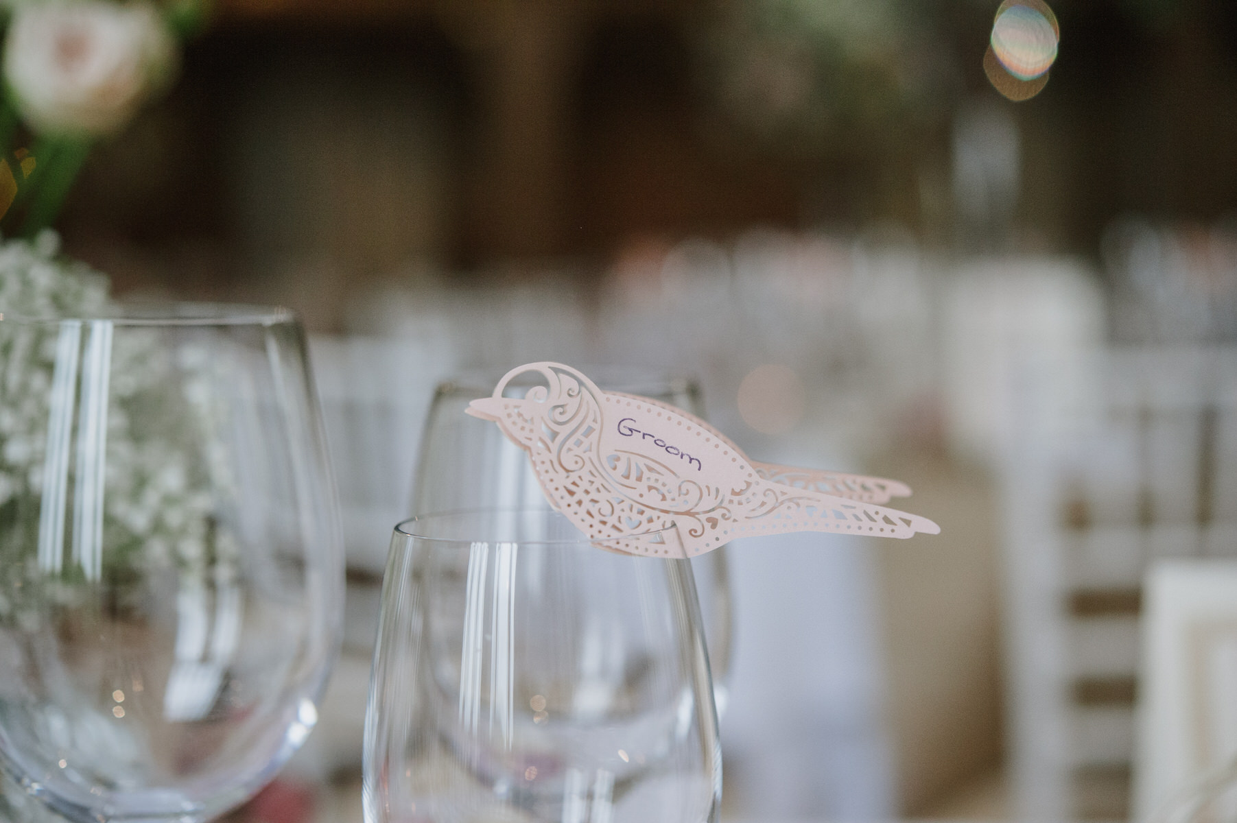Cain Manor wedding place names bird design