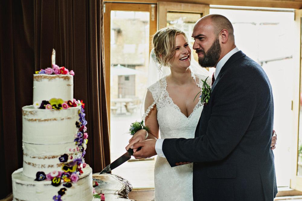 Herons Farm Barn wedding cake cuttin