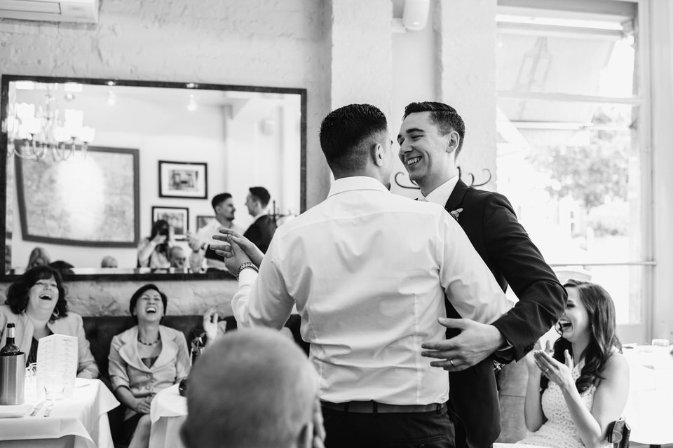 two men dancing at wedding