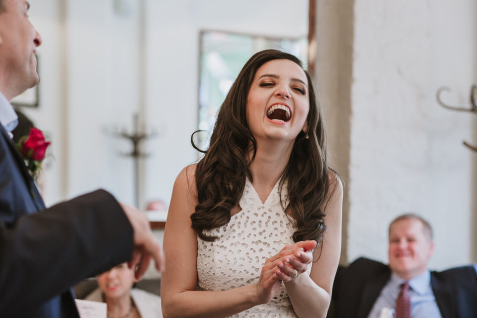 bride laughing at Le Salon Prive