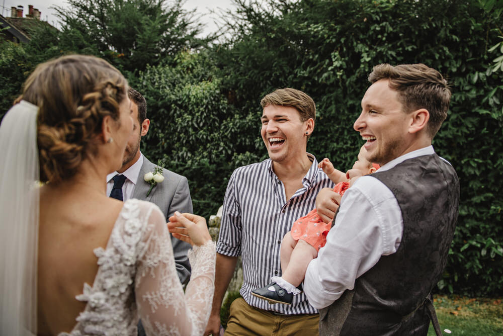 guest laughing with bride