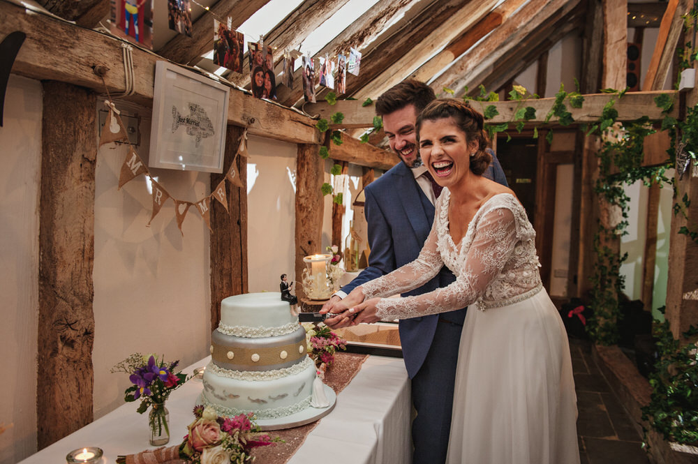 bride and groom cutting the cake Rumbolds farm wedding