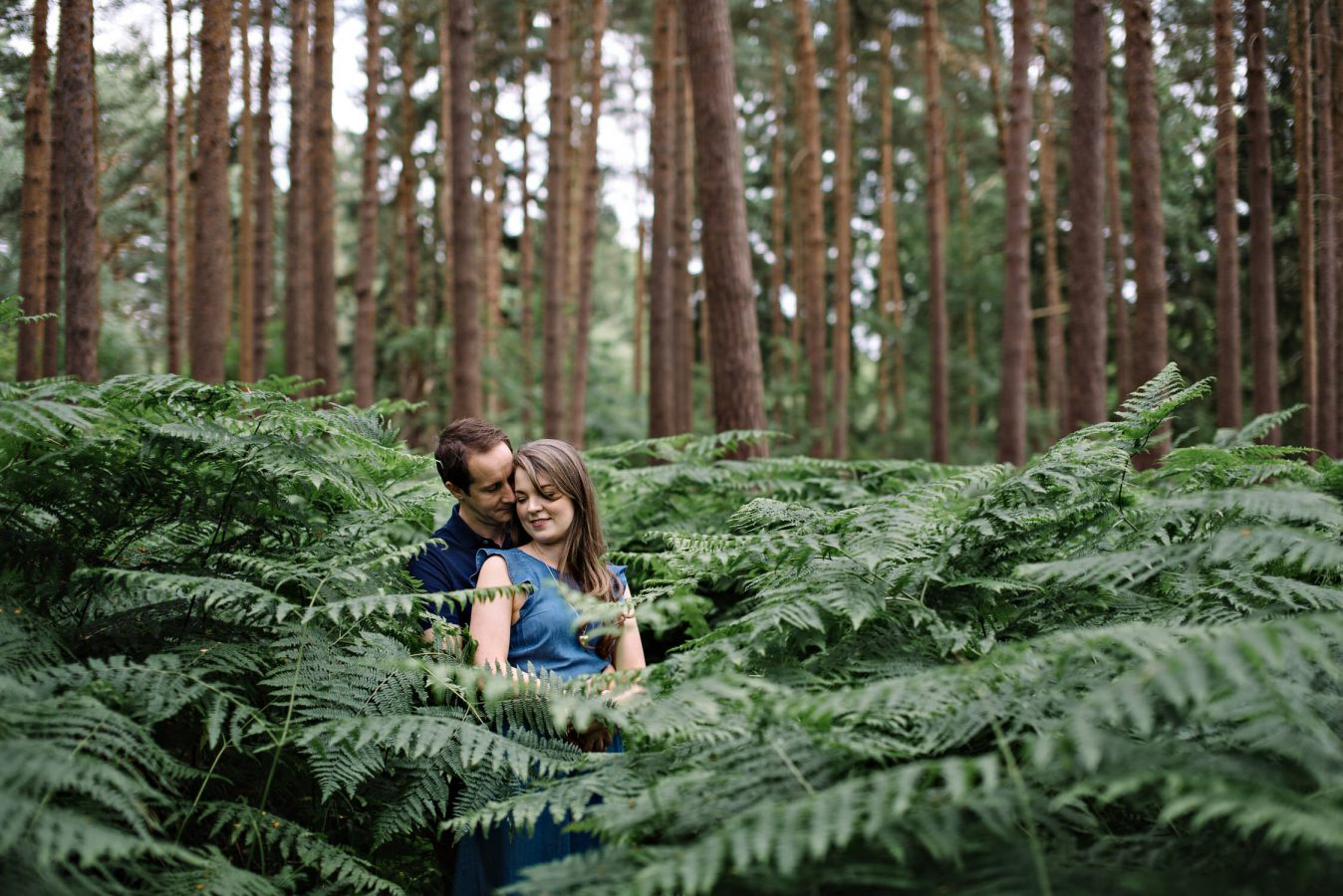 engagement photography Surrey couple standing in grass