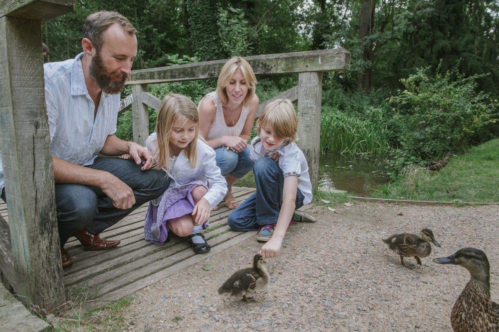 family feeding ducks Surrey photographer